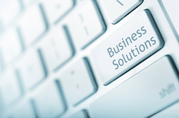Keyboard text stating business solutions